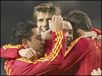 Spain celebrate their goal against England at Old Trafford