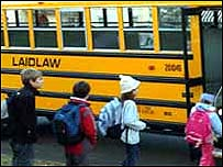 Children board a Laidlaw yellow school bus