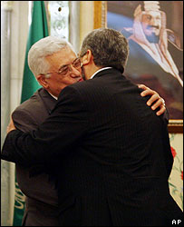 Palestinian faction leaders embrace after reaching agreement
