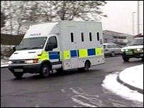 The police van carrying the suspects