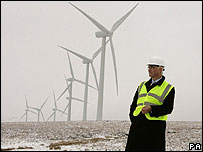 Alistair Darling in front of wind turbines (Image: PA)