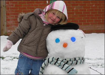 Girl with snowman. Photo: Sarah Freeman