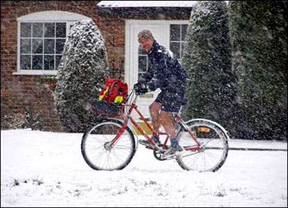 A postman in the snow in Raunds, Northamptonshire
