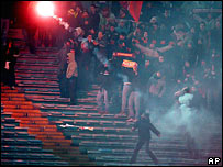 A flare is thrown during a Italian Serie A between Roma and Milan in January 2006