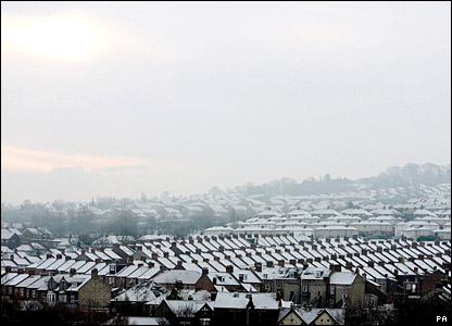 The sun shines on snow-covered rooftops in Newcastle