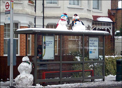 Snowmen at a bus stop in East Finchley, London.