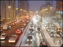 Gridlocked traffic in the snow in Birmingham city centre