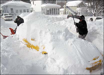 Residents of Oswego dig out their car