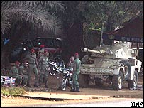 Guinean soldiers stand guard on the streets of the capital, Conakry (file picture)