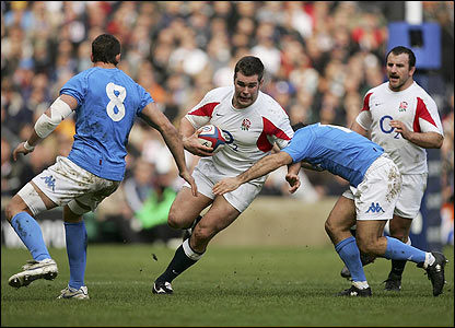 England flanker Nick Easter makes a break through Italian defence