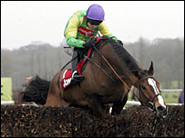 Kauto Star jumps the last fence in the Aon Chase