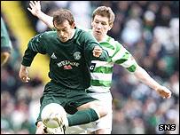 Celtic defender Mark Wilsaon keeps and eye on Steven Fletcher