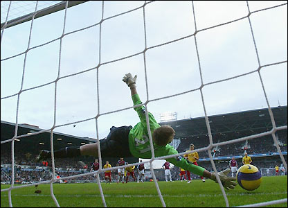Robert Green fails to keep out Henderson's penalty