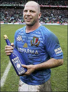 Italy's veteran scrum-half Alessandro Troncon claims the man of the match award