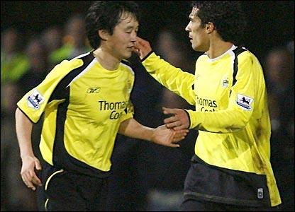 Sun Jihai and Bernardo Corradi celebrate the equaliser