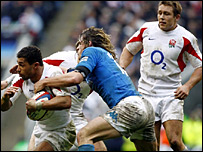 England's Jason Robinson is tackled