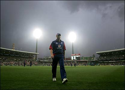 Andrew Flintoff leads England off the field in the rain