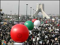 Iranians attend a rally in Tehran to mark the 28th anniversary of the Islamic revolution