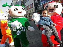 Mascots play with a kid in Beijing