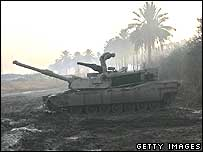 US soldier standing on Abrams tank