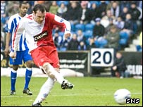 Kris Boyd scores from the spot