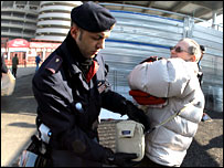 Fans are searched by police at the San Siro