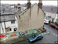 House with Banksy mural