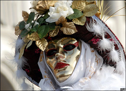 Venetian in gold mask
