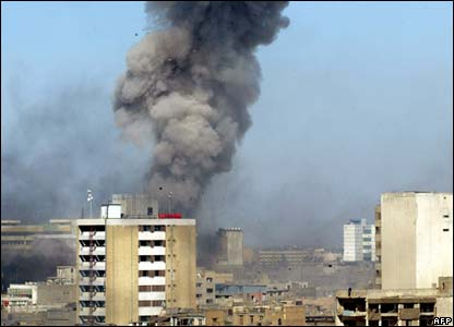 Smoke rises over the Baghdad skyline as the first of the bombs goes off