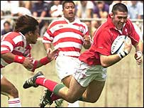 Andy Lloyd scores for Wales against Japan in 2001