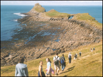 Walkers at Worm's Head on Gower (picture: National Trust Photo Library)
