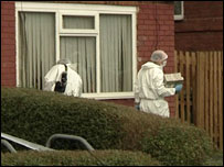 Forensic teams examine the scene