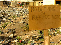 """No dumping"" sign in front of rubbish heap"