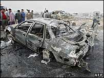 Burnt-out car at the scene of the blast
