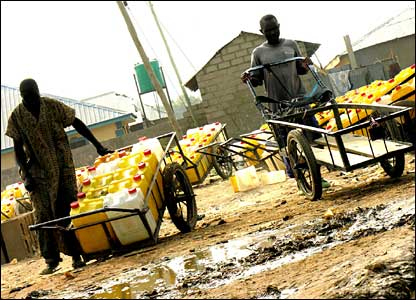 People selling water on waste ground