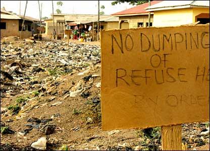 "Sign saying ""No rubbish"" on rubbish tip"