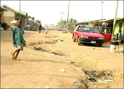 Boy walks down dirt track