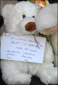 A teddy bear with a message left outside the house