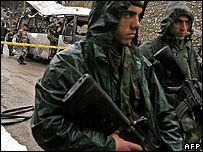 Troops guard the scene of double bus bombing