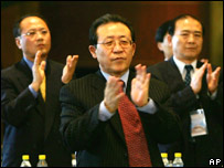 North Korean nuclear envoy Kim Kye Gwan (centre) and aides