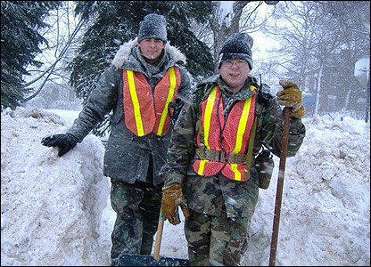 Mike Kieloch and friend clearing snow