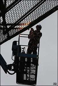 British army engineer at work dismantling the watchtower