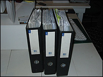 Three folders of tax credit documents built up by Sanna and her husband