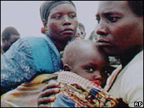 A Rwandan woman, man and child