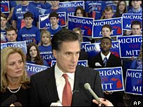 Mitt Romney answers a press question in front of a sea of supporters
