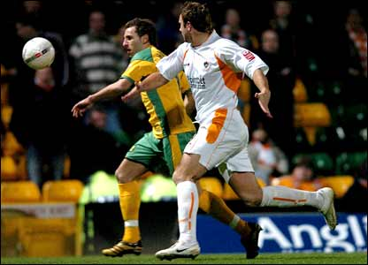 Norwich's Darren Huckerby (left) struggled to get past Blackpool's Ian Evatt