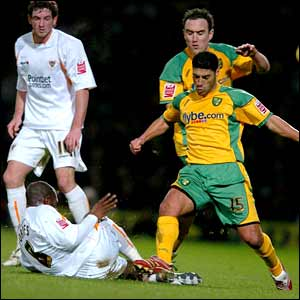 Norwich City's Youssef Safri tussels with Blackpool's Adrian Forbes (floor)