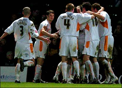 Michael Jackson is hidden by his team-mates after putting Blackpool ahead