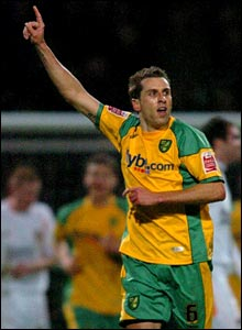 Darren Huckerby celebrates his equaliser for Norwich