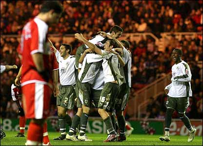 City celebrate after Jamie McCombe's goal